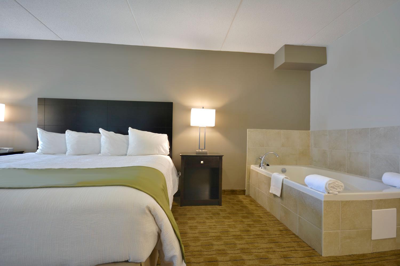 luxury king suite bedroom soaker tub view 1