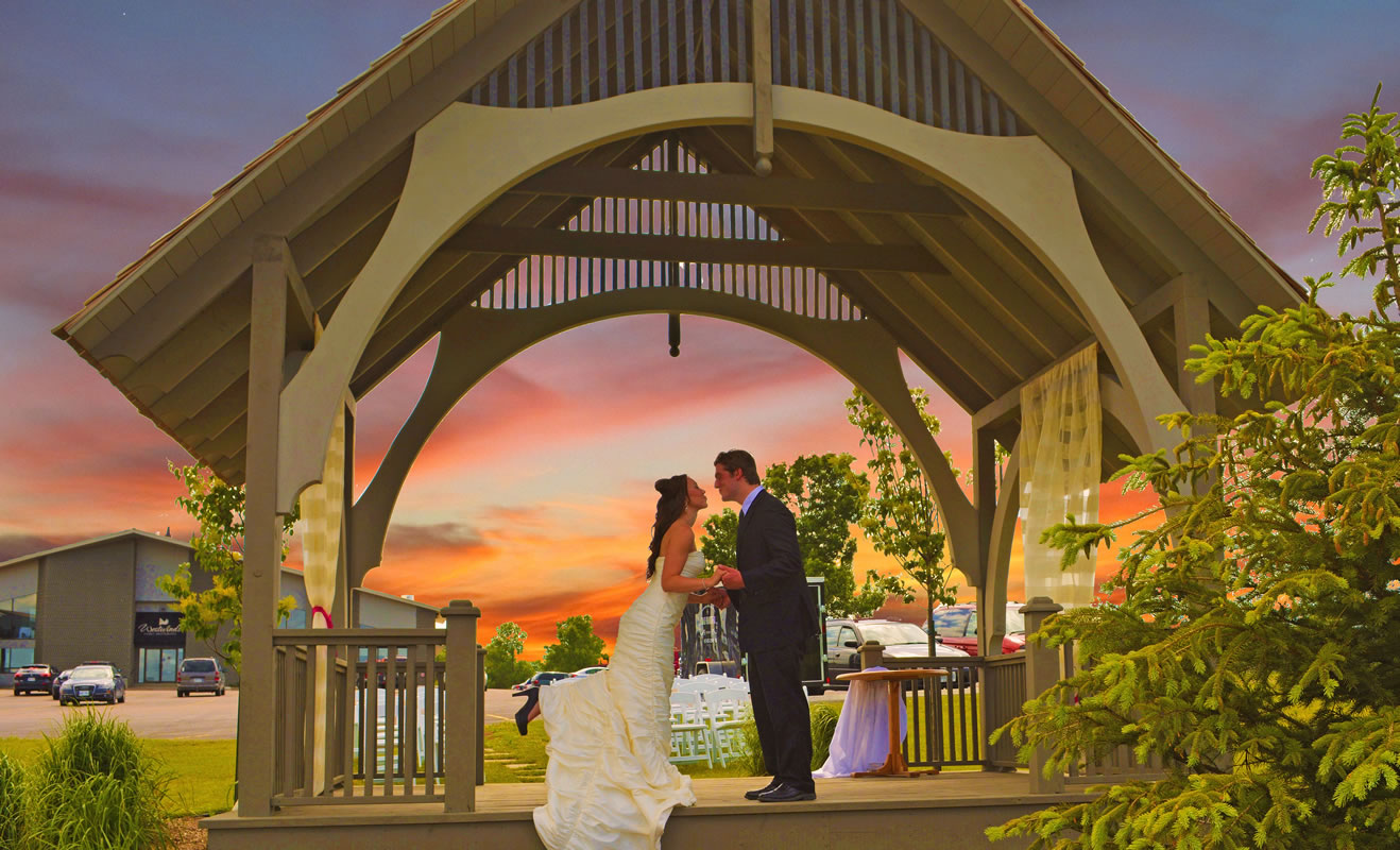 Bride and Groom in the Gazebo under the Sunset