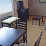 Executive Queen Suite Sitting/ Dining Area with Country View
