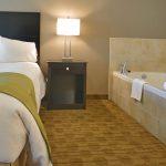 Luxury Suite Sleep Area & Spa Tub- View 2